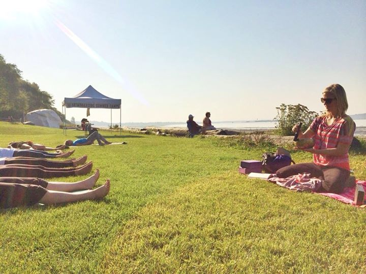 Lauren Roegele leading a seaside yoga class during the White Rock Sea Festival